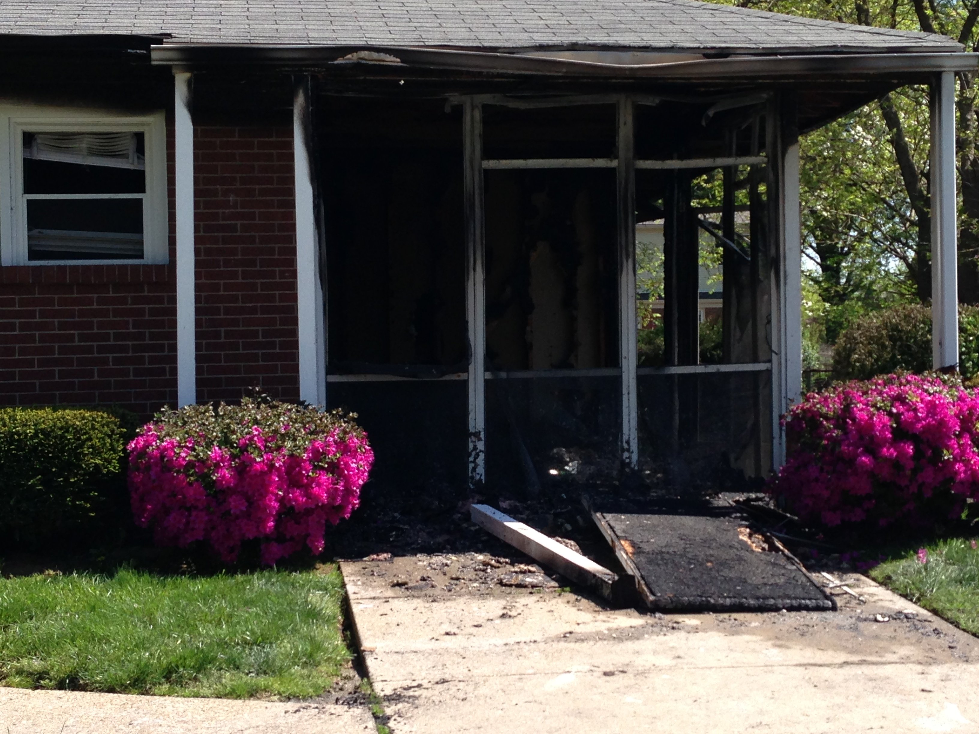The enclosed sun porch was completely destroyed in the arson fire