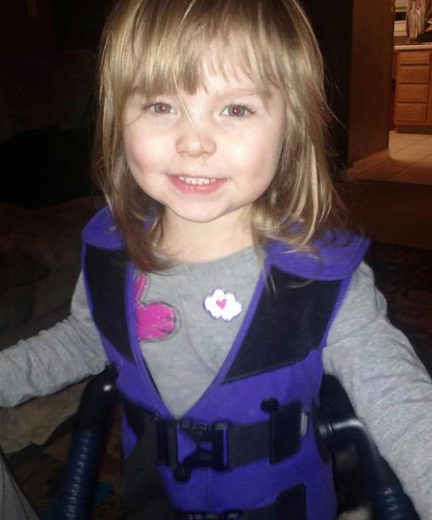 """2-year-old Karcin Pay ton is wearing """"The Vest"""" - a special device that helps break up mucus in her lungs. Her family says their insurance company will not pay for the cost of the vest."""