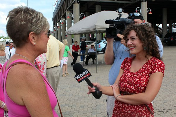WDRB's Emily Mieure and photojournalist James Zorn speak with passengers about board the Belle of Cincinnati Wednesday afternoon for the 2013 Great Steamboat Race.