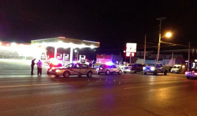 Louisville Metro Police respond to shooting at 26th and Broadway.
