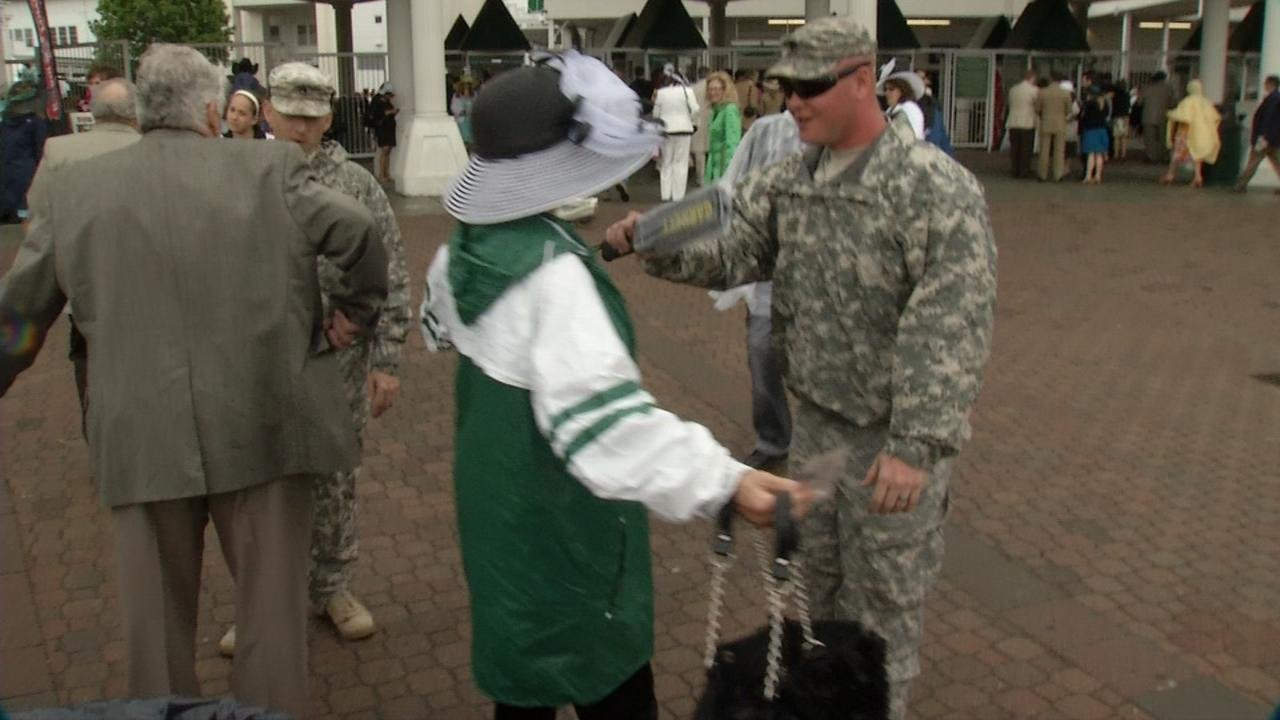 A woman at Churchill Downs is wanded as part of increased security measures for Derby 139.