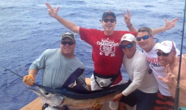 Photo from Jody Demling, Cardinal Authority.com, University of Louisville basketball coach Rick Pitino with an 80-pound white marlin he caught with friends in the Bahamas.