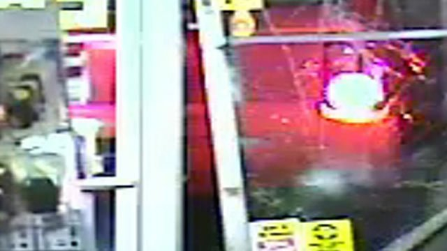 A suspect accused of stealing lottery tickets from a convenience store used a car to smash through the front doors.