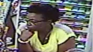 Police say this woman brought lottery tickets stolen from Next Door Convenience Store to The Top Notch Convenience Grocery to cash them.