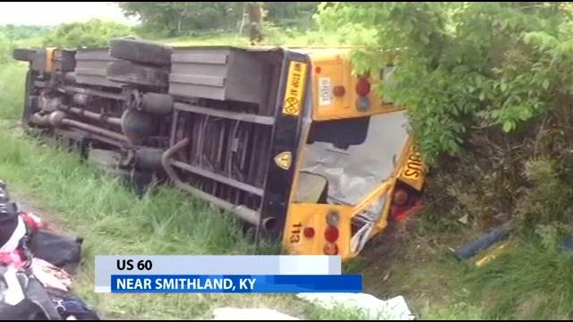School bus that carried Union Co. H.S. softball team rests on its side in a ditch along U.S. 60 near Smithland, Ky., Friday.