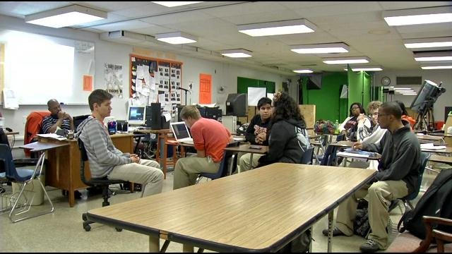 Fern Creek H. S. video production students sit in classroom and studio.