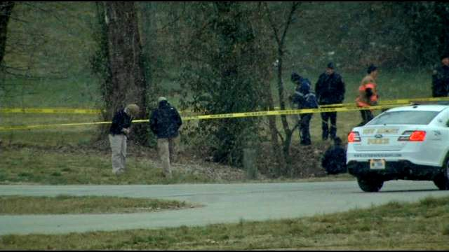 Police looked for clues after a woman and her two children were found naked in a creek in New Albany's Binford Park in March of 2013.