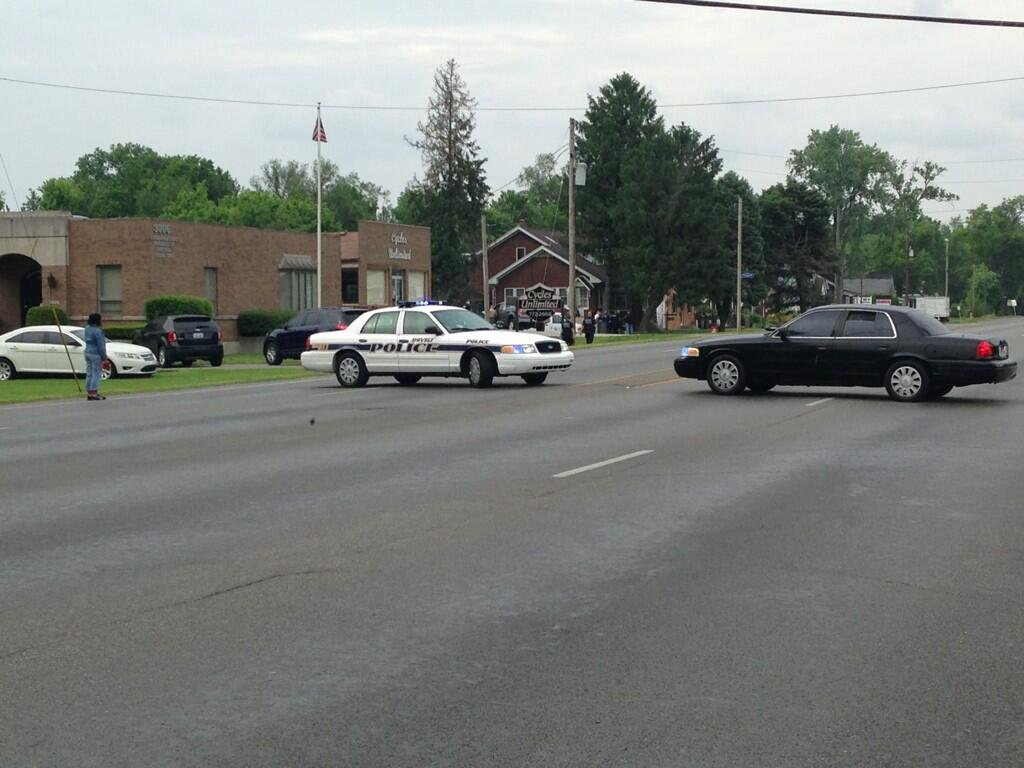 Police vehicles block Dixie Highway during a police standoff Friday afternoon.