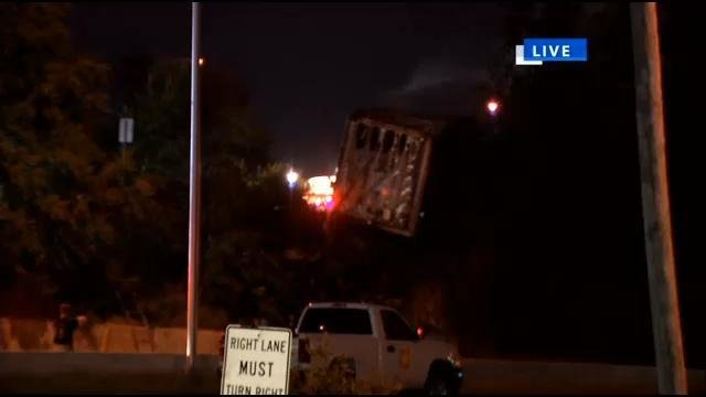 Construction workers pulled the driver to safety after the cab of the 18-wheeler burst into flames.