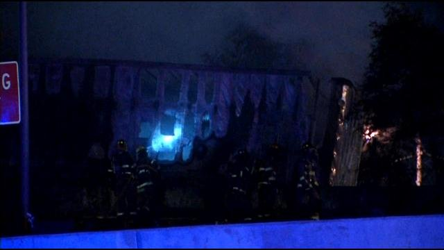 Firefighters assess the damage after a tractor-trailer veered off the road and over a barrier at the exit ramp near Hurstbourne Parkway early Tuesday.