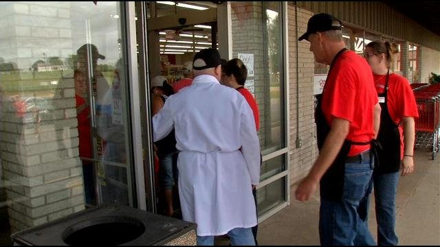 Customers entering the new Cash Saver store in Georgetown after its grand opening on May 22.
