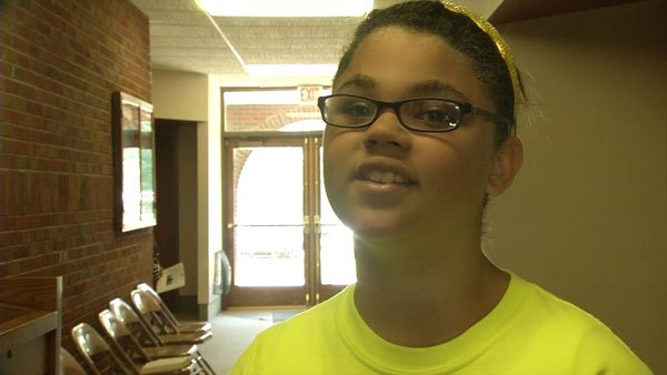 Erica Hughes, age 9, spoke at an interfaith Memorial Day service Monday morning.