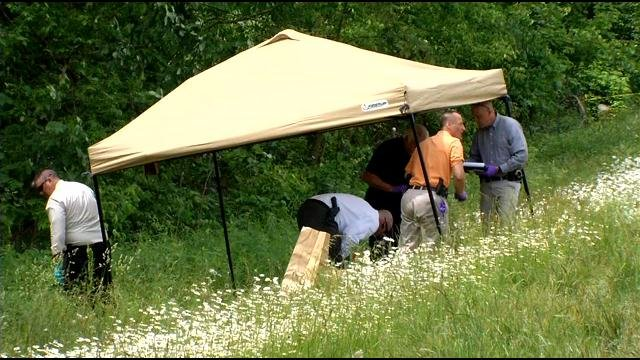 Investigators looking for clues and evidence after a mowing crew found the body of a woman along I-65 near Elizabethtown on May 29.