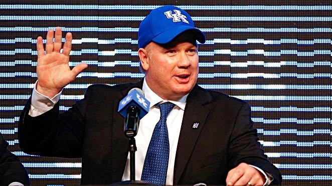Three pre-season college football yearbooks endorse Kentucky's hiring of Mark Stoops but pick the Wildcats seventh in the SEC East.