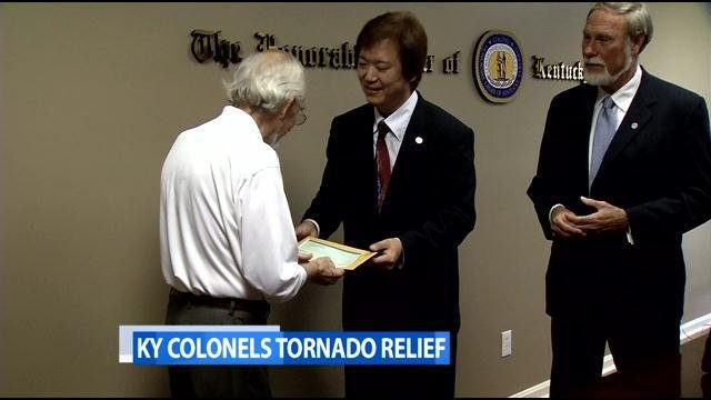 Shun Fujiki presents check of $13,600 to Kentucky Colonels