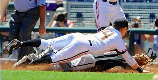 Cole Sturgeon of Louisville was tagged out at first as the Cards lost to Oregon State and exited the College World Series