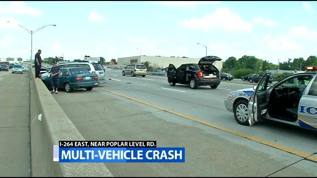 Police say 6-8 cars were involved in a wreck on eastbound I-264 during rush hour that sent 2 people to the hospital