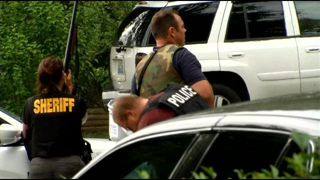 Clark Co. sheriff's officers standing at perimeter of Sellersburg standoff, June 24. Jeff Gordon/WDRB News