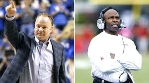 Mark Stoops of Kentucky and Charlie Strong of Louisville are stirring up plenty of college football talk this summer.