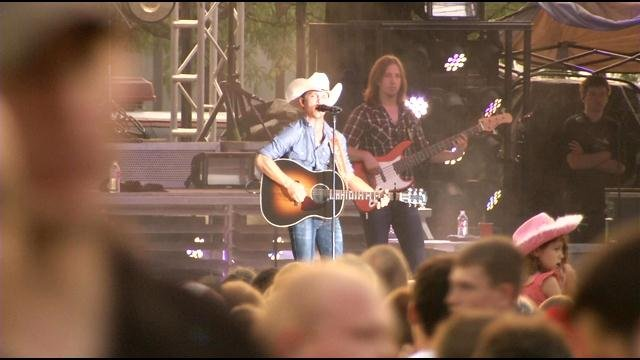 Country singer Justin Moore performs at the Waterfront Independence Festival in Louisville.