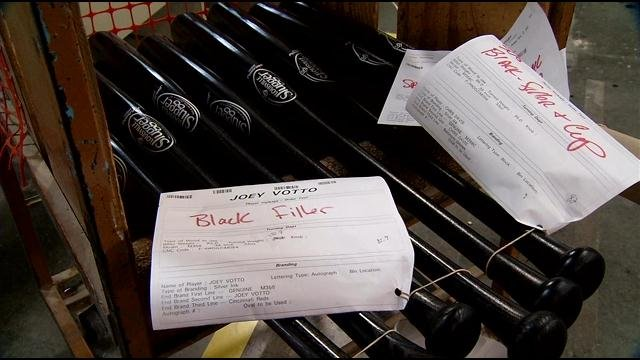 Specially-made Louisville Slugger bats await shipment to Reds player Joey Votto. WDRB news photo.