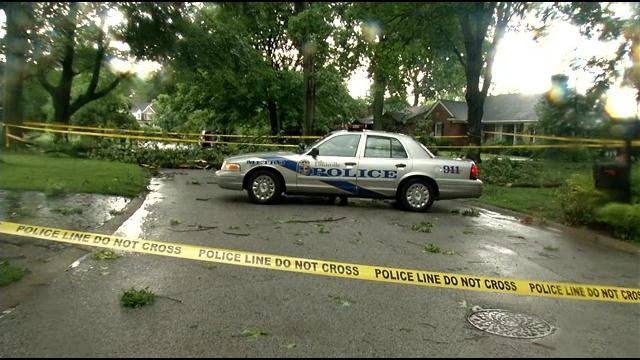 AN LMPD patrol car blocked the street where a 10-year-old boy was hit by a falling tree during severe storms on July 10.