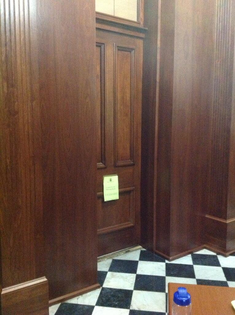 Metro council members began their deliberations behind this closed door of a city hall conference room at 10:04 p.m. Wednesday.  Bennett Haeberle/WDRB News