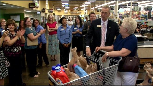 Ruby Newton raced through the aisles of the Hillview Kroger. She won a two-minute shopping spree to grab as many groceries as she could.