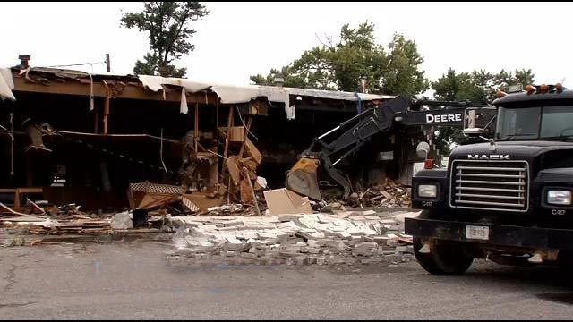 Heavy machinery pulled away parts of what was Jerry's Restaurant in Jeffersonville, Ind. Wednesday morning.