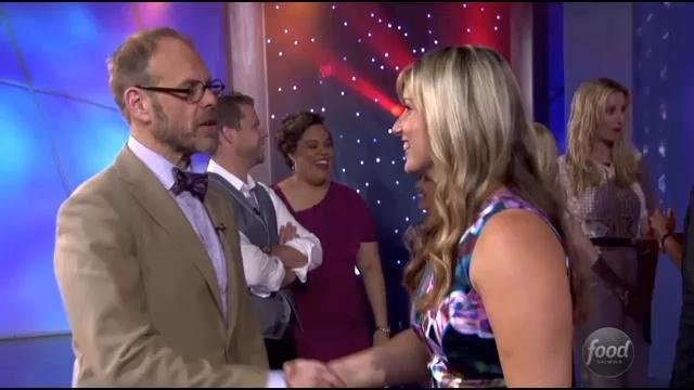 Damaris Phillips being congratulated by the Food Network's Alton Brown
