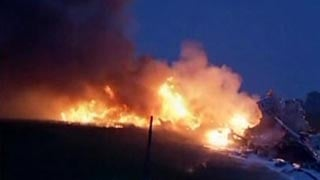 Massive flames shot into the air after the UPS plane crashed into an Alabama field
