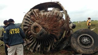 The plane went down early Wednesday morning and broke into pieces near the Birmingham, Ala. airport.