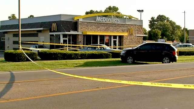 Police crime scene tape surrounded a McDonald's in PRP after shots were fired at an LMPD officer Thursday night.