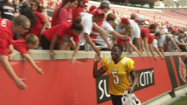 No autographs, but Teddy Bridgewater did half a lap around the stadium to high five fans after practice Sunday.