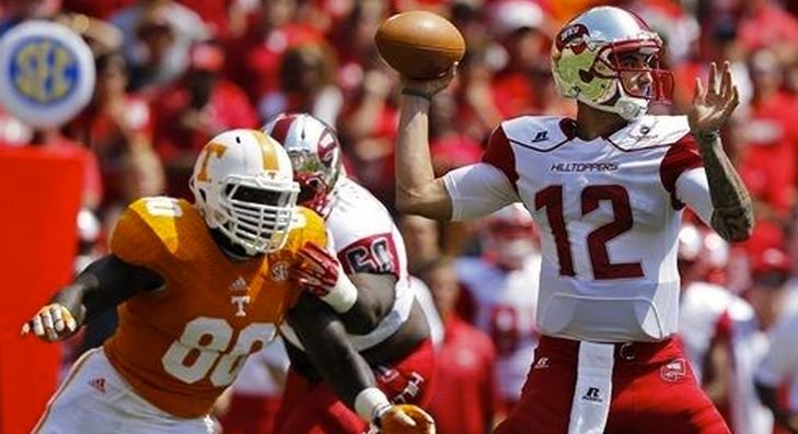 Western Kentucky quarterback Brandon Doughty (12) threw five interceptions in WKU's 52-20 loss at Tennessee Saturday.