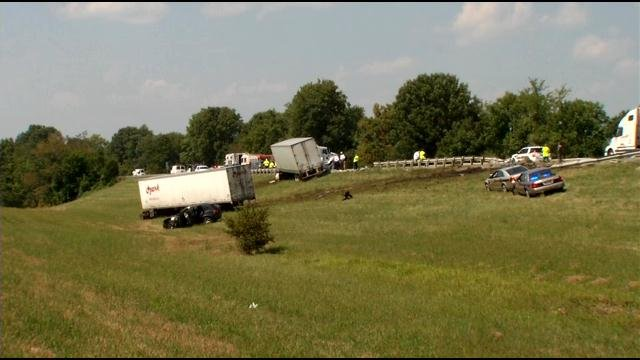 """Scene of two crashes that resulted in deaths of two """"good Samaritans"""" along I-64 Westbound, east of Shelbyville, Ky., Monday. WDRB News."""