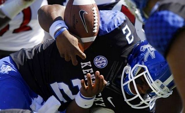 Jalen Whitlow's first-quarter fumble was the first of several Kentucky mistakes in UK's 27-13 loss to Louisville Saturday.