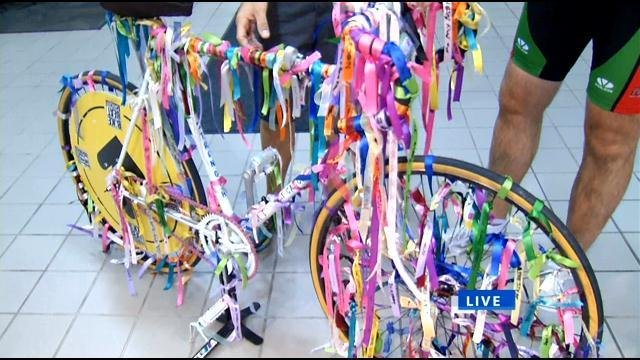 Each ribbon on this special bike is dedicated to those who have battled cancer