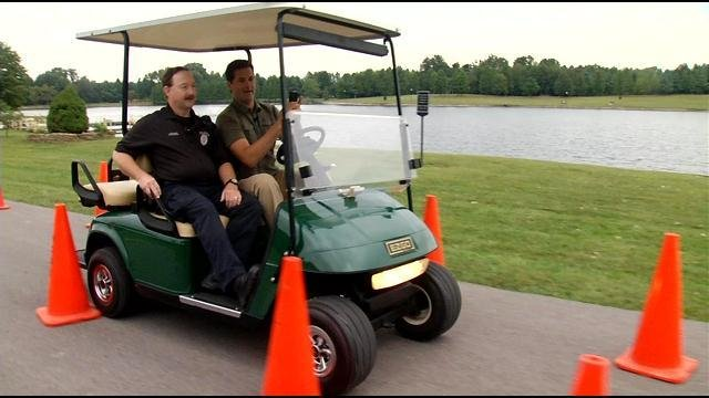Keith Kaiser tries out texting and driving on a golf cart.