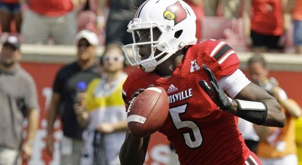 © Associated Press photo. Teddy Bridgewater threw for four TDs in a 72-0 rout of FIU.