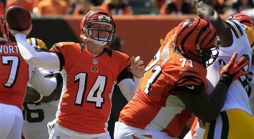 © Associated Press photo. Bengals quarterback Andy Dalton gets rid of it under pressure in Sunday's win over Green Bay.