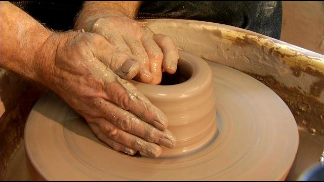 The skilled hands of Melvin Rowe, master potter and artist.