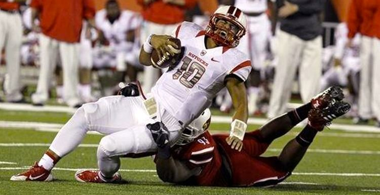 Louisville's Roy Philon sacks Rutgers quarterback Gary Nova in the Cards' 24-10 win Thursday.