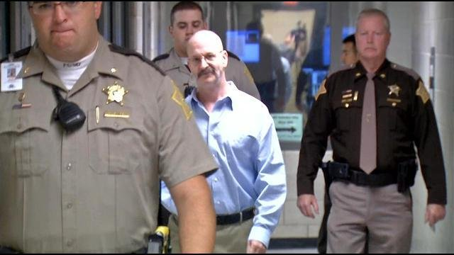 William Clyde Gibson was escorted to court on Oct. 21 for the first day of testimony in his capital murder trial.