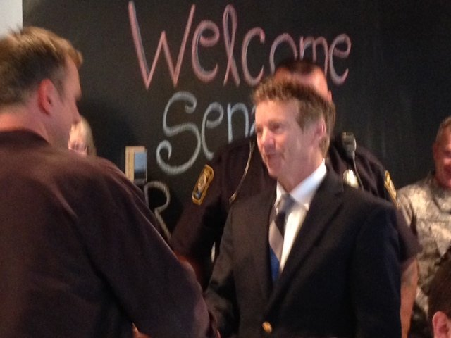 Sen. Paul shakes hands with constituents at Just Baked Bakery in Bardstown, Ky.