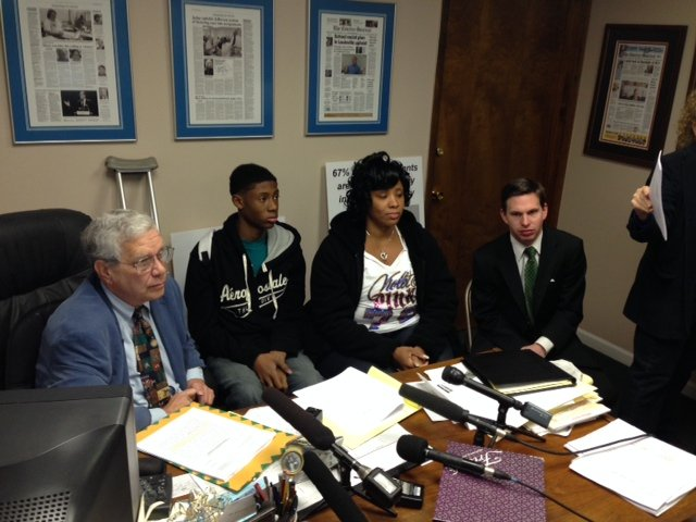Ted Gordon sits next to the alleged victim and his mother