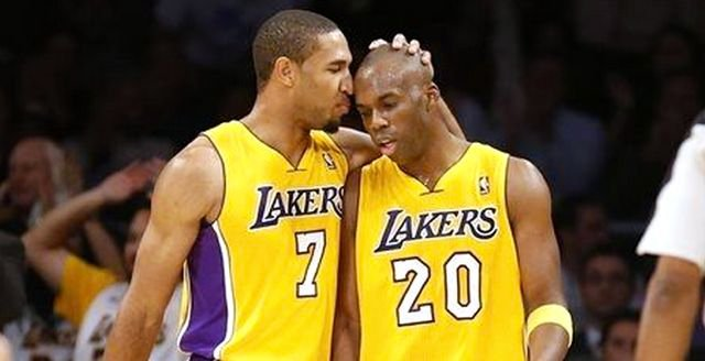Former UK star Jodie Meeks (20) is congratulated by teammate Xavier Henry while leading the Lakers to an opening-night NBA win.