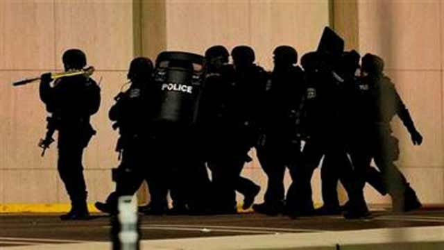 (AP Photo/Julio Cortez). Officials wearing tactical gear walk outside of Garden State Plaza Mall following reports of a shooter, Monday, Nov. 4, 2013, in Paramus, N.J.