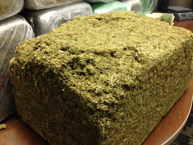 "The compacted bricks of marijuana measure 19"" x 12"" x 9"""