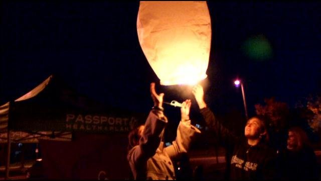 March of Dimes supporters in Louisville raise awareness for premature births by releasing lanterns into the sky.